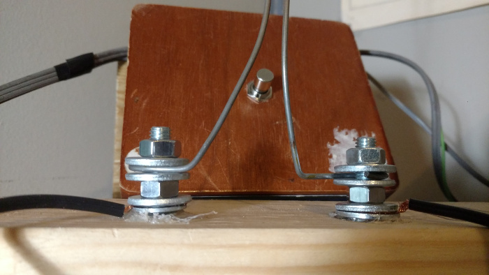 the spark-gap, made of coathanger wire held in place with nuts, bolts, and washers. A top-down view of the switchbox is in the background.